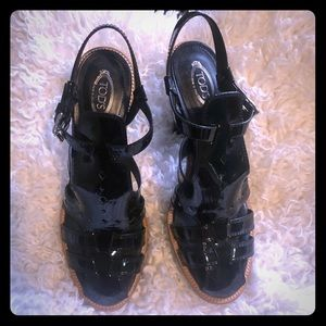 Very comfortable black platform Tod's sandals.